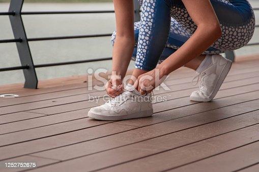 1142900322 istock photo Happy athletic woman doing  exercises 1252752675