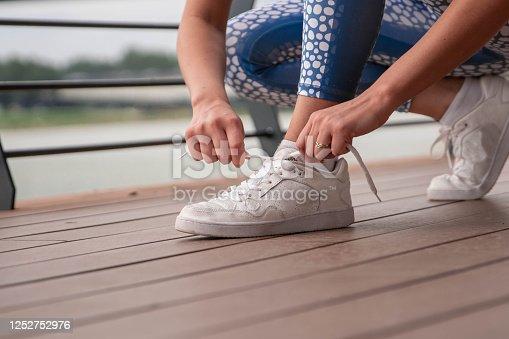 1142900322 istock photo Happy athletic woman doing  exercises 1252752976