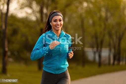 1142900322 istock photo Happy athletic woman jogging in nature. 1142901507