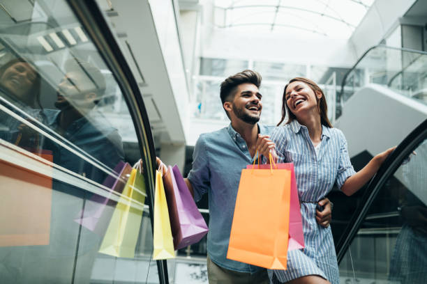 Happy attractive loving couple enjoy shopping together stock photo