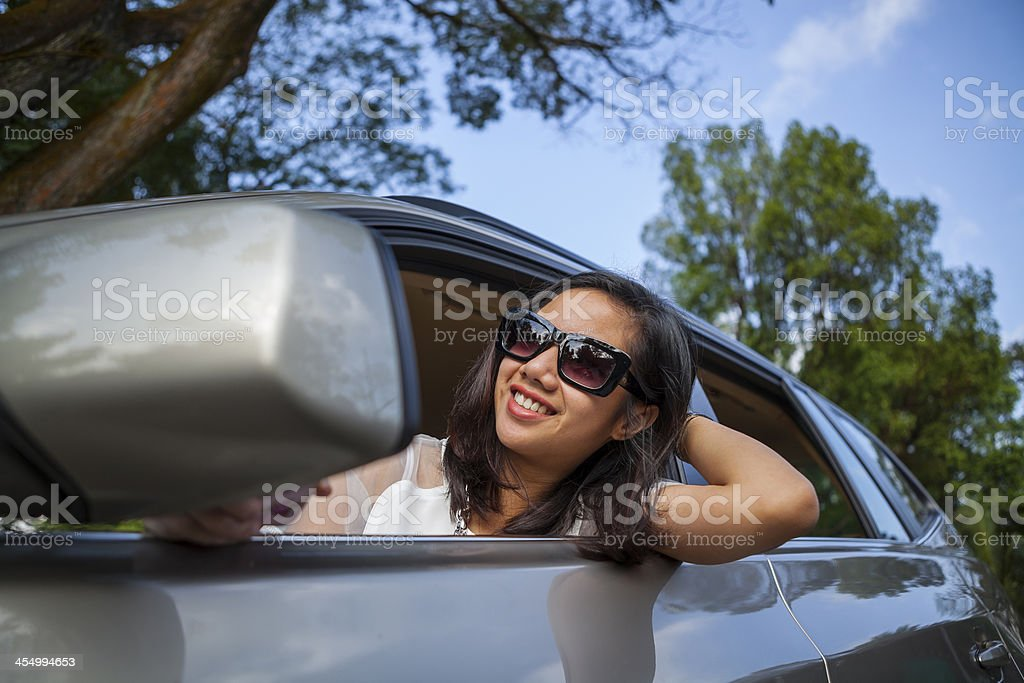 Happy attractive woman in car royalty-free stock photo