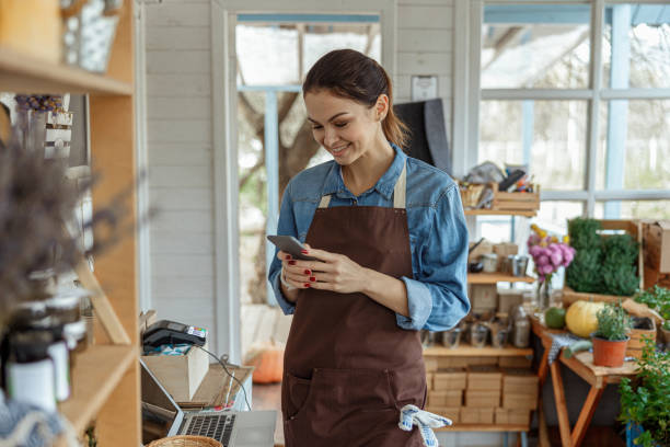 Happy attractive woman staring at her gadget stock photo