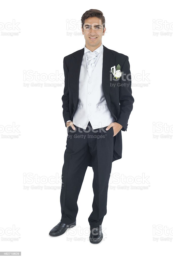 Happy attractive young groom looking at camera stock photo