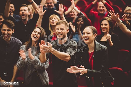 483876497 istock photo Happy audience applauding in the theater 1207064525