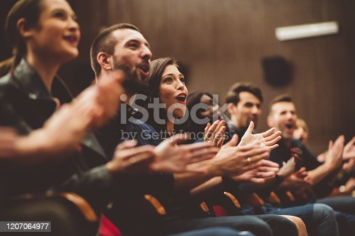 483876497 istock photo Happy audience applauding in the theater 1207064977