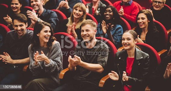 483876497 istock photo Happy audience applauding in the theater 1207065646