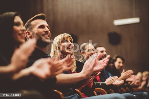 483876497 istock photo Happy audience applauding in the theater 1207066033