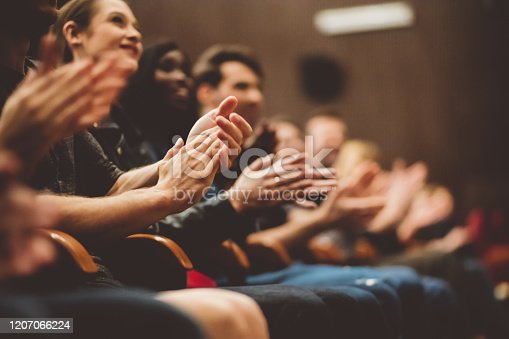 483876497 istock photo Happy audience applauding in the theater 1207066224