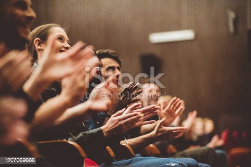 483876497 istock photo Happy audience applauding in the theater 1207069666