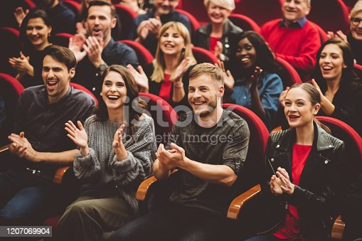 483876497 istock photo Happy audience applauding in the theater 1207069904