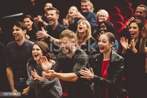 483876497 istock photo Happy audience applauding in the theater 1207070670