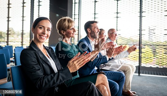 862720340 istock photo Happy audience applauding speaker at business conference 1203007916