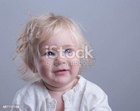 istock happy baby blue eyes blonde 487112156