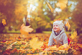 Cute child having fun in autumn park