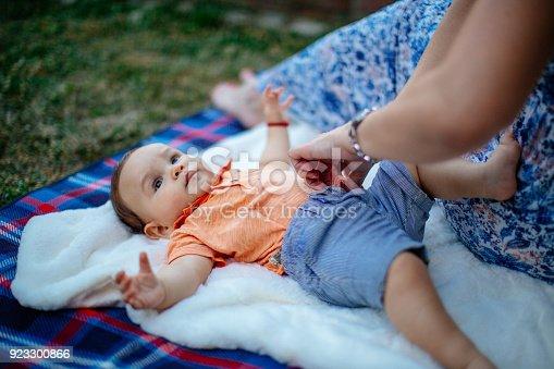istock Happy baby boy with parents 923300866