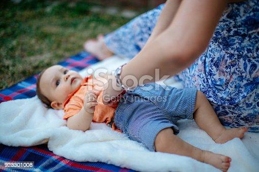 istock Happy baby boy with parents 923301008