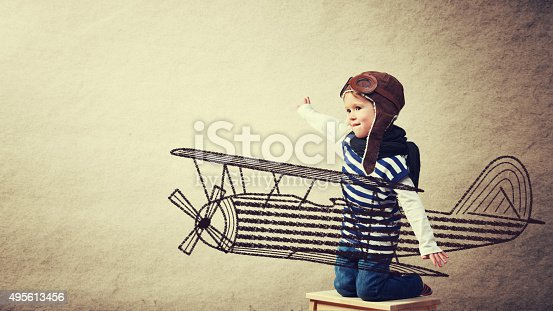 istock Happy baby dreams of becoming a pilot aviator 495613456
