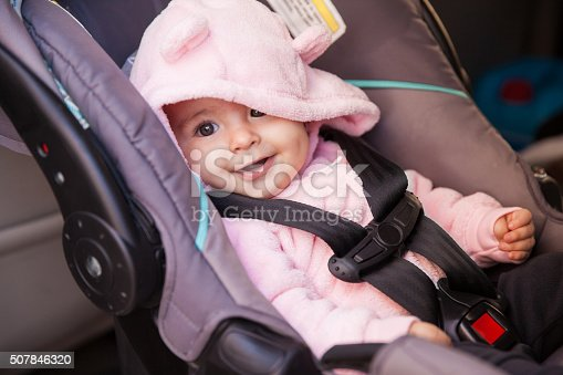 istock Happy baby girl in a car seat 507846320