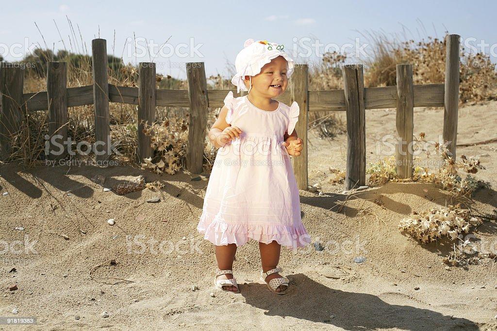 happy baby girl on the beach royalty-free stock photo