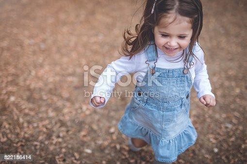 678589610istockphoto Happy baby girl 822186414