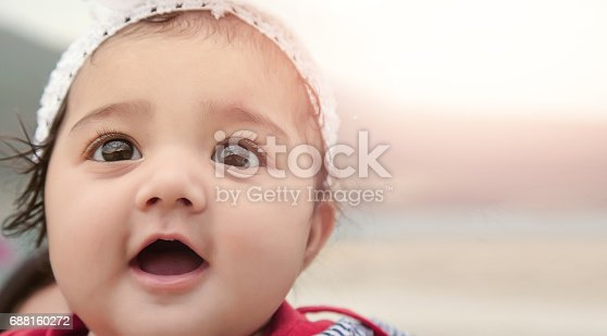 istock Happy Baby Girl with Background for Copy-Space. 688160272