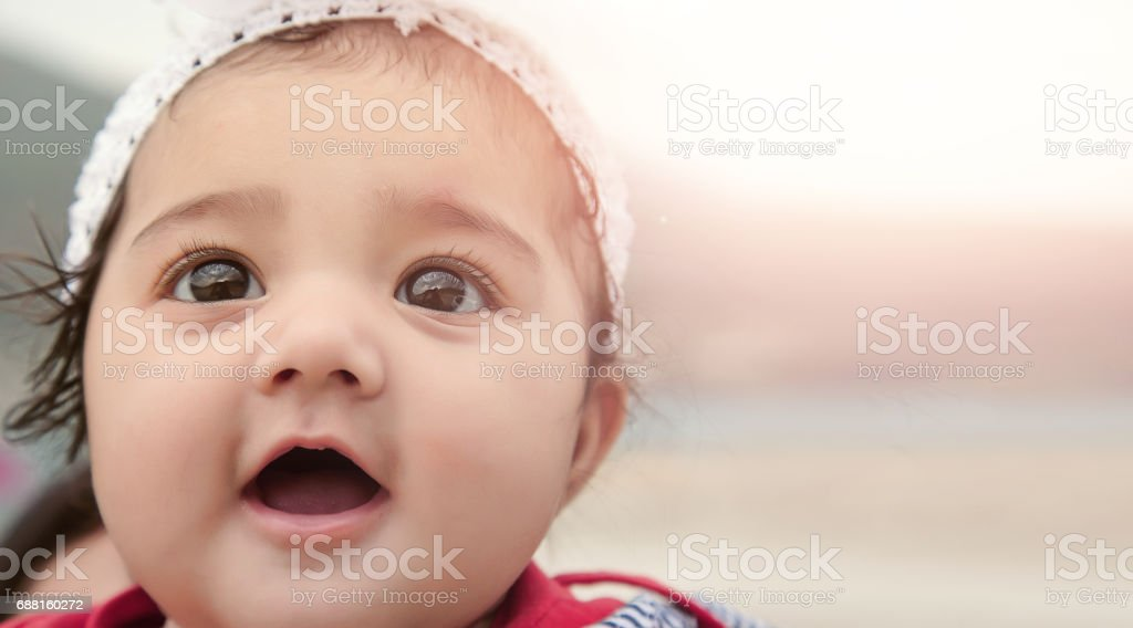 Happy Baby Girl with Background for Copy-Space. stock photo