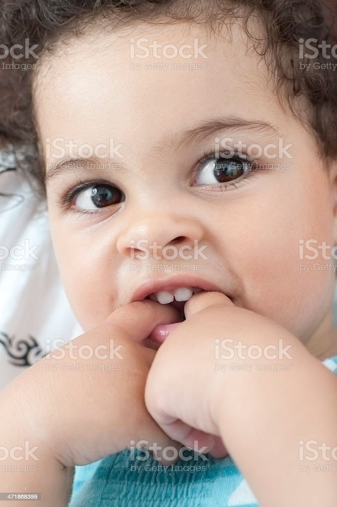 Happy Baby Girl With Fingers In Mouth royalty-free stock photo