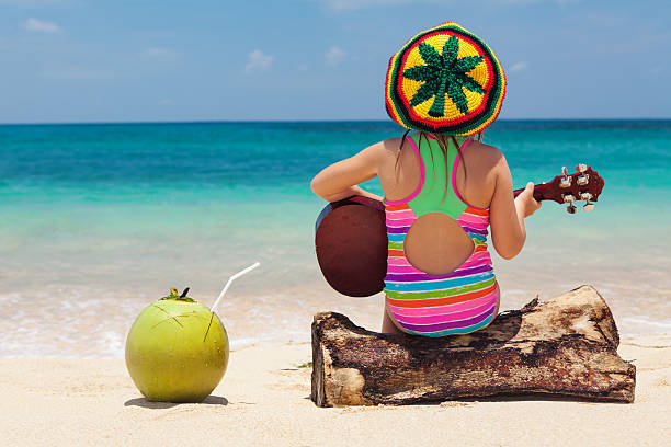 Happy baby have fun on summer tropical beach holiday stock photo