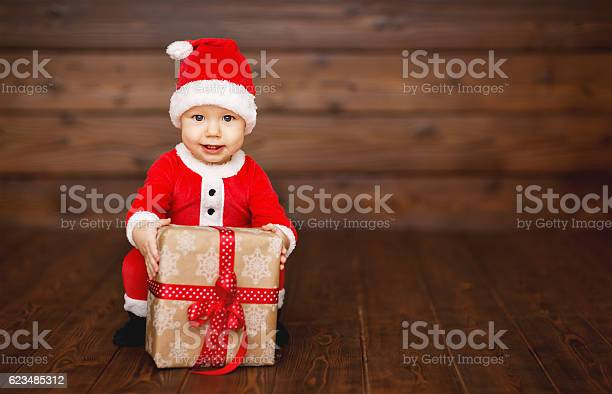 Happy baby in a christmas costume santa claus with gifts picture id623485312?b=1&k=6&m=623485312&s=612x612&h=iudk2v7atudozhnoopyxr4ljzmxl uwk  z2ta4vvc0=