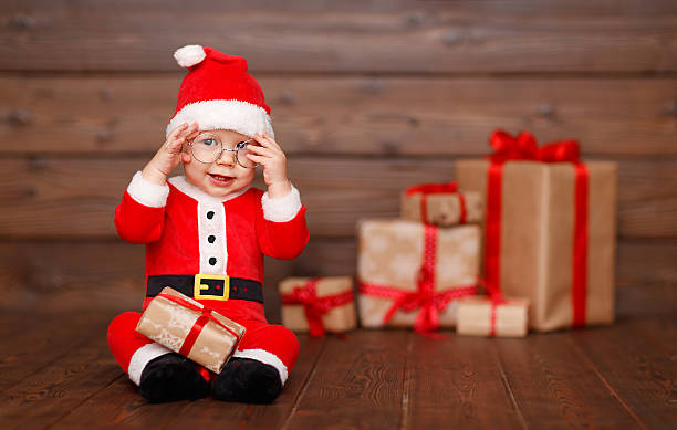 Happy baby in a christmas costume santa claus with gifts picture id623829172?b=1&k=6&m=623829172&s=612x612&w=0&h=thtlmogm uqqybov0jtmsmnmmyeg5hrlgrdj29zhrqq=