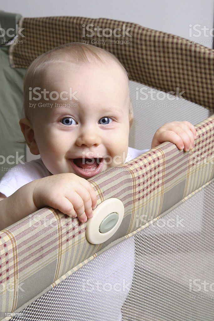 Happy Baby in a Playpen stock photo