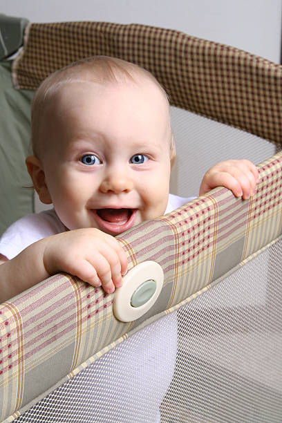 happy baby in a playpen - playpen stock pictures, royalty-free photos & images