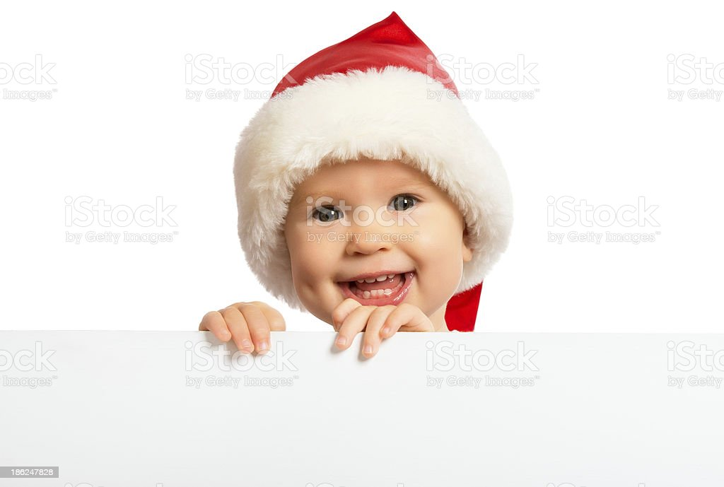 happy baby in Christmas hat and a blank billboard isolated royalty-free stock photo