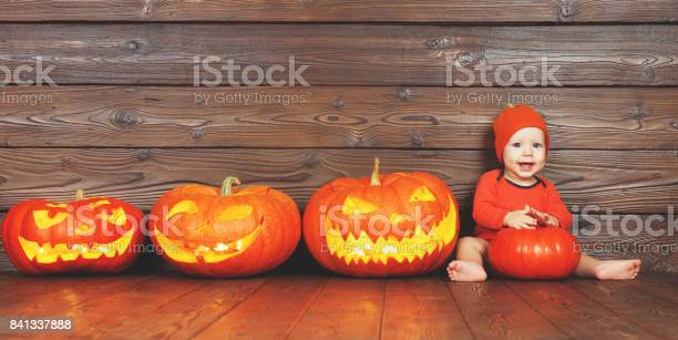 Happy baby in costume for halloween with pumpkins on wooden picture id841337888?b=1&k=6&m=841337888&s=612x612&h=hdsscuquk4uk21t5ph0hv90 h umztpn frlhgm1ws0=