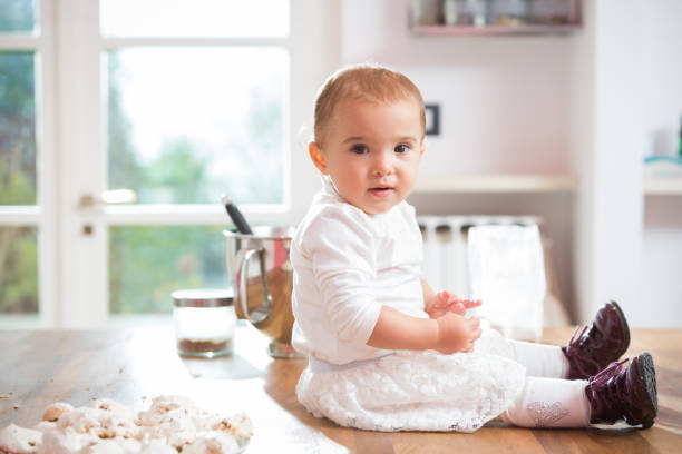happy baby in the kitchen baby in the kitchen famiglia stock pictures, royalty-free photos & images