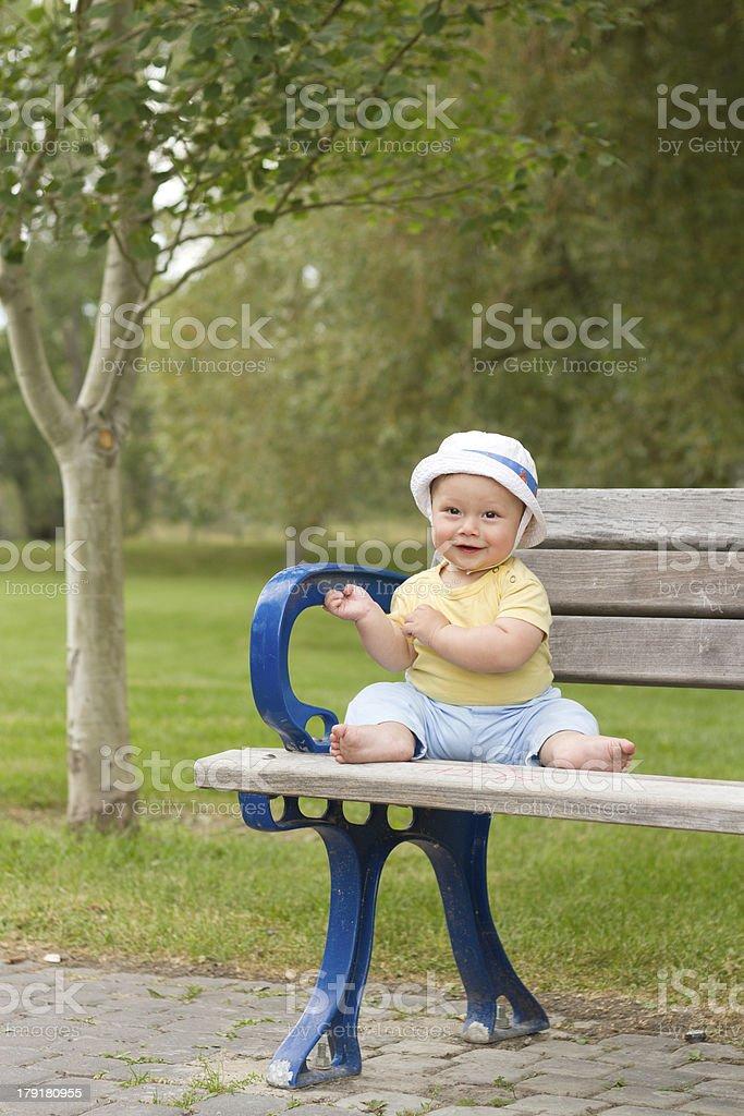 Happy Baby on Park Bench royalty-free stock photo