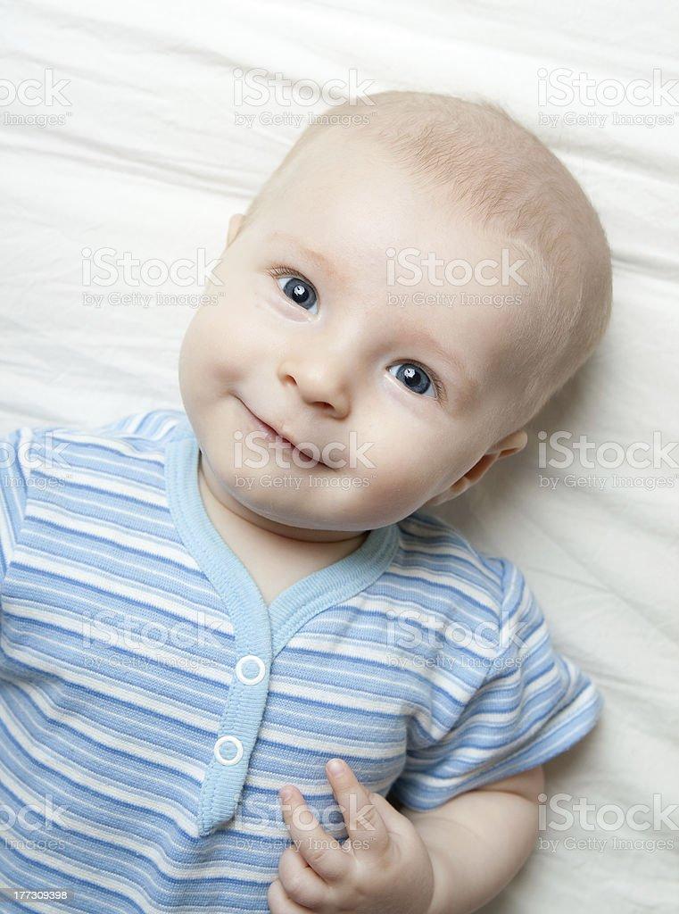 Happy baby on the sheet royalty-free stock photo