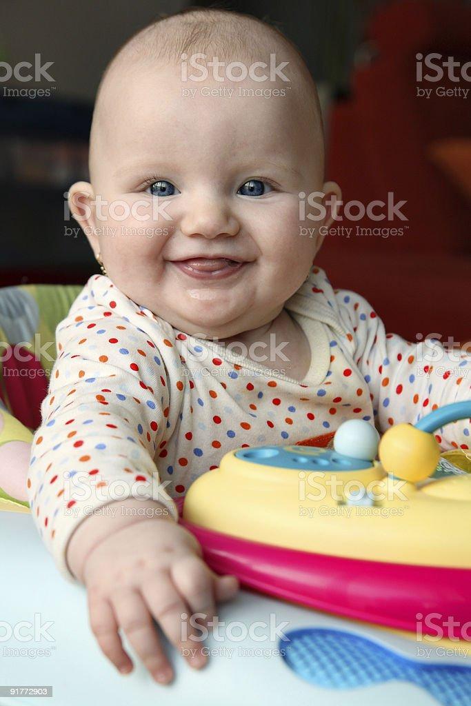 Happy baby smiling at camera royalty-free stock photo