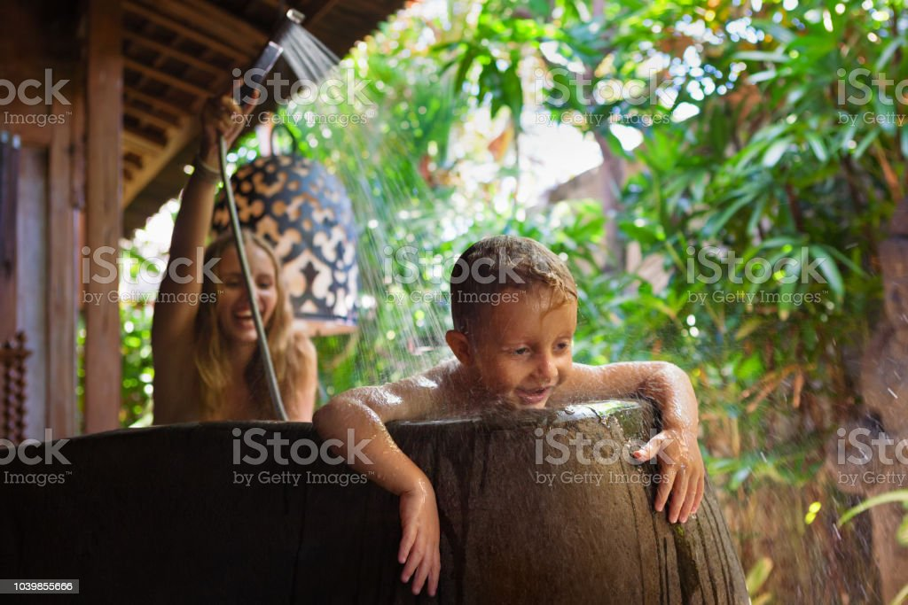 Happy Baby Son With Mother Have Fun In Outside Bathroom