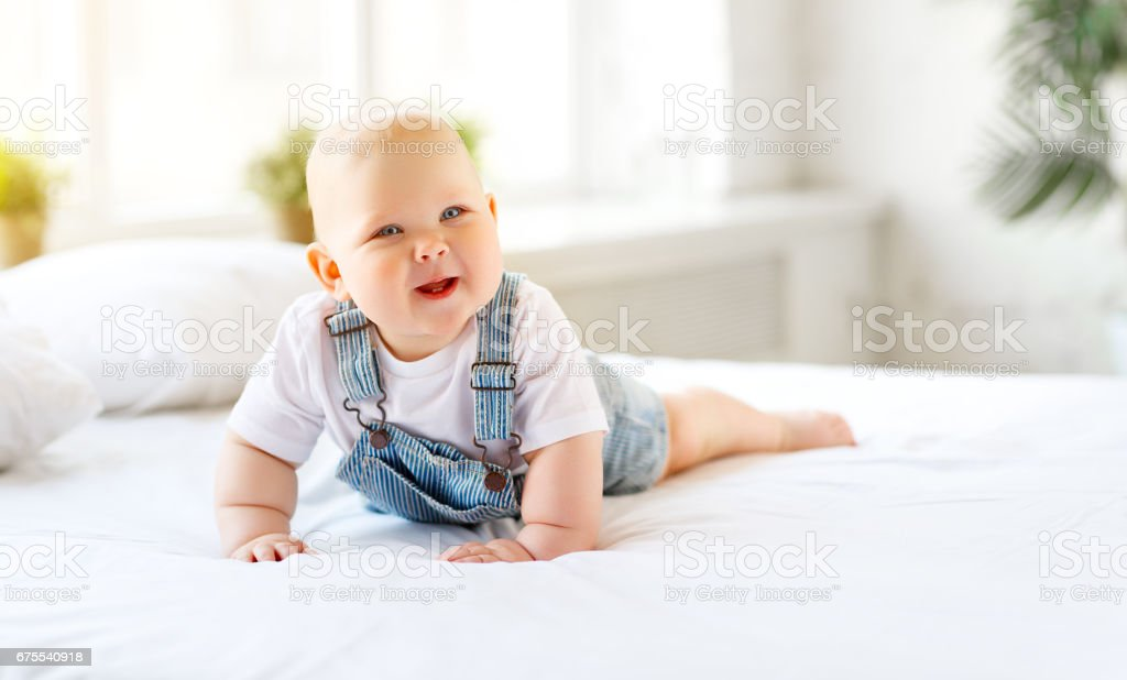 Happy baby toddler in bed royalty-free stock photo