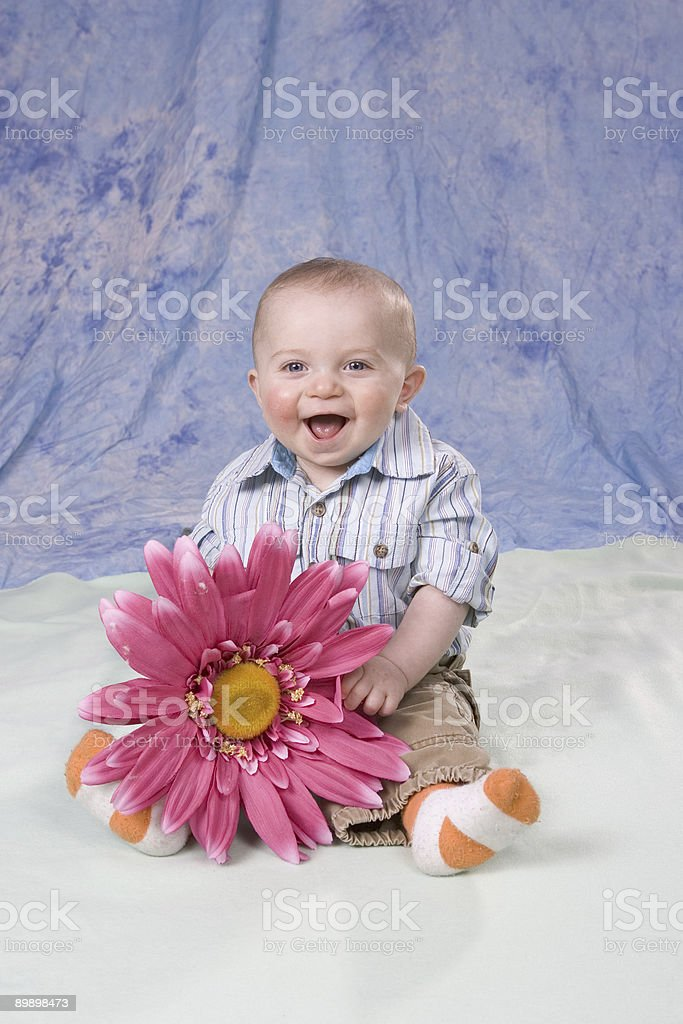 Happy Baby with Large Daisy royalty-free stock photo