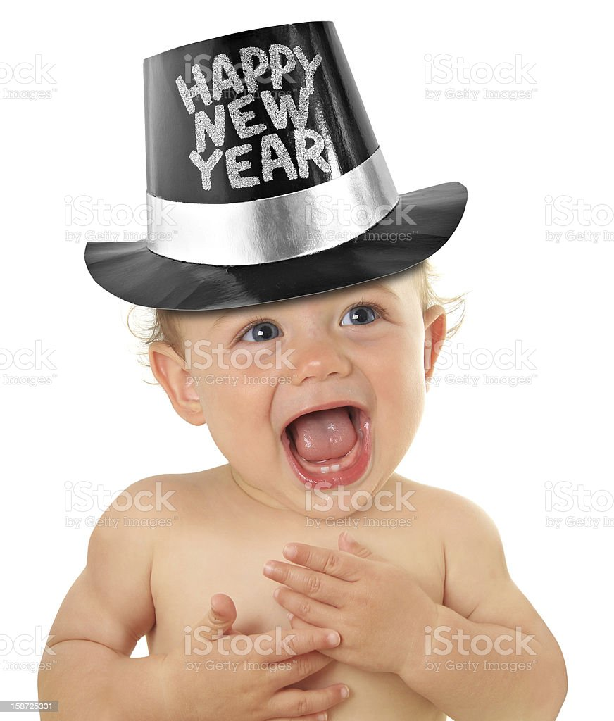 Happy baby with new years eve hat on stock photo