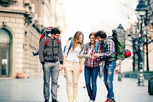 happy backpackers in the city. - belgrade serbia stock photos and pictures