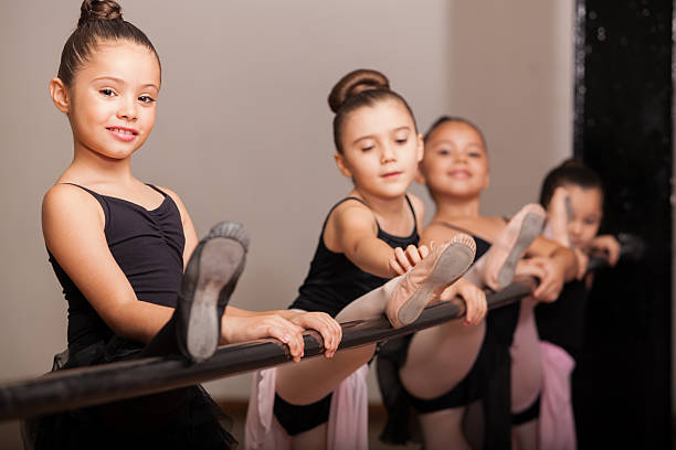 Happy ballet dancer during class stock photo