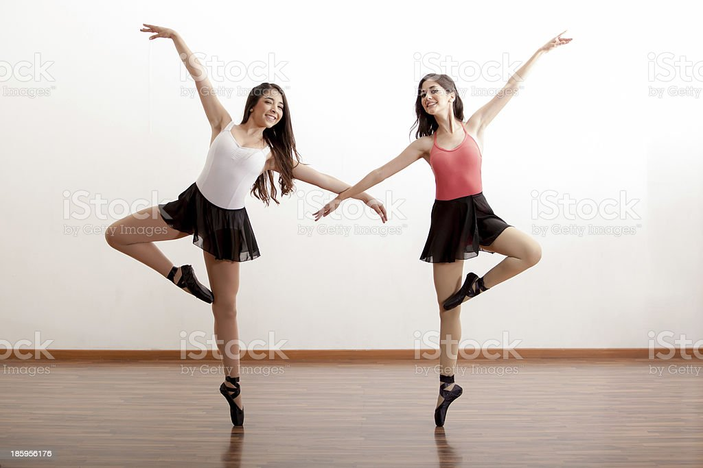 Happy ballet dancers in a studio stock photo