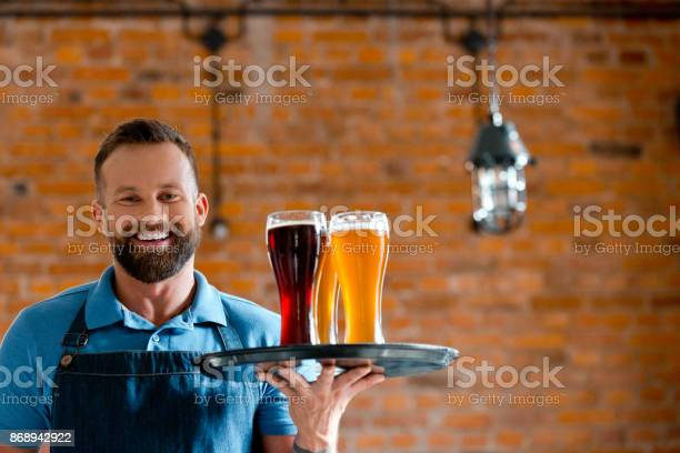 Happy Bartender Holding Serving Tray With Glasses Of Beer Stock Photo - Download Image Now