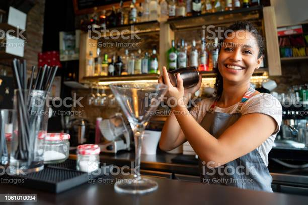 Happy bartender mixing drinks at the bar picture id1061010094?b=1&k=6&m=1061010094&s=612x612&h=vcpz13eucm cynriqpb2rkwa1hvxebsas5ey7xhsrbc=