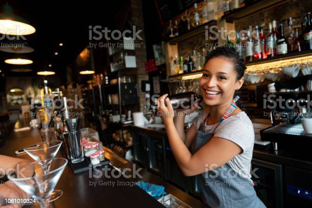 Happy bartender mixing drinks at the bar picture id1061010324?b=1&k=6&m=1061010324&s=612x612&h=1ary9o93r29mcqewe5pe9lsgl9 uzkmnkbjv xuvb g=