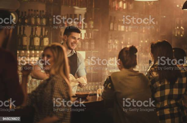 Happy bartender talking to his customers in a pub picture id945026622?b=1&k=6&m=945026622&s=612x612&h=prq88ewy5c45w5a2g4 07ghnrzvbjybtr057na0aai8=