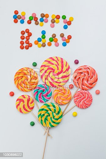 istock Happy B-day lollipop candy sweets bouquet. Holiday baloons conce 1030898022